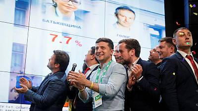 On course for election win, Ukraine president offers alliance with rock star's party