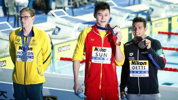 Swimming - Bad blood boils over as Sun wins 400, Horton refuses podium