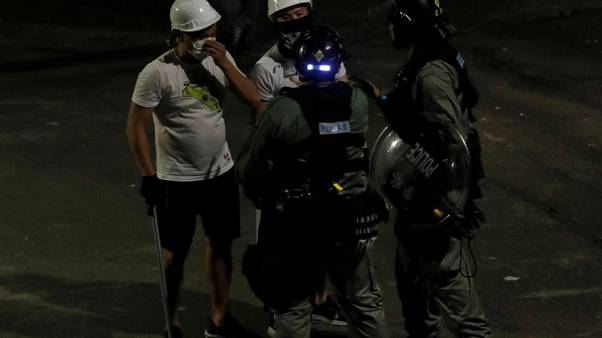 Hong Kong police criticised over failure to stop attacks on protesters