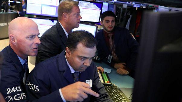 Stocks rise on earnings; sterling falls