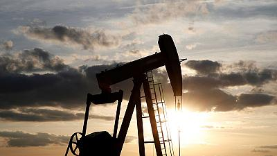 Oil prices gain on U.S. inventory drop, Middle East tensions