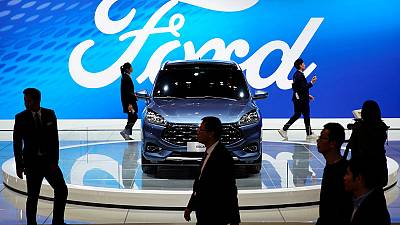 Ford results dented by restructuring, gives weaker-than-expected forecast