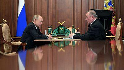 Putin allies' oil feud spills into public view
