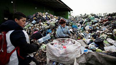 Argentine waste pickers find livelihood, community in mountain of trash