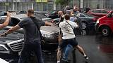 Assailant jumps on ex-Ukraine president's car after he leaves questioning