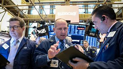 Wall Street rebounds, dollar gains on solid GDP data, upbeat earnings