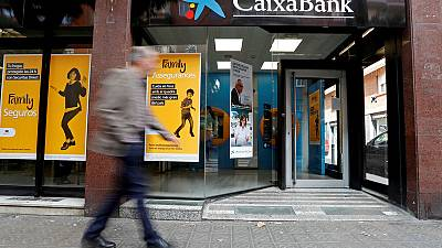 Spain's Caixabank second-quarter net profit falls 85% due to restructuring costs