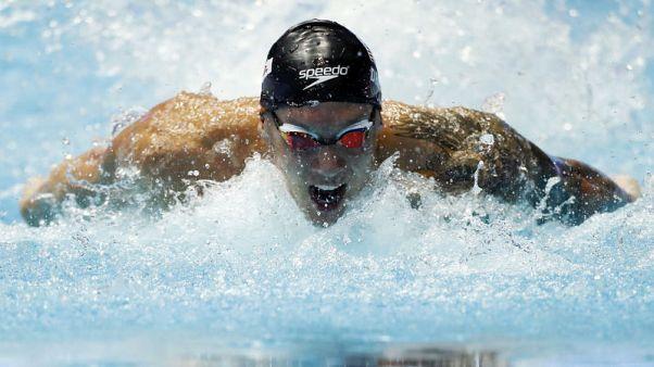 الأمريكي دريسل يحطم الرقم القياسي العالمي لسباق 100 متر فراشة في جوانج جو