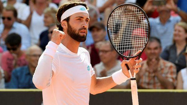 Tennis - Basilashvili battles past Zverev into Hamburg title clash