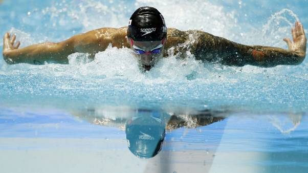 Dressel earning comparisons to Phelps at world championships