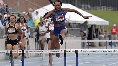 Athletics: Muhammad sets 400m hurdles world record, Lyles wins 200m