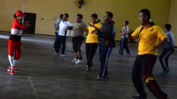 في إندونيسيا.. رجال الشرطة تحت رحمة برنامج قاس لإنقاص الوزن