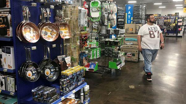U.S. consumer spending, prices rise moderately