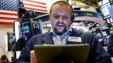 وول ستريت تفتح منخفضة وسط مخاوف التجارة وترقب اجتماع المركزي