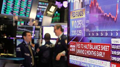Dollar jumps, stocks fall after Fed rate outlook; pound stalls