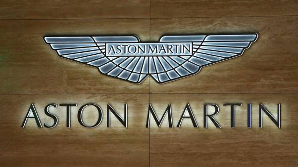 Carmaker Aston Martin swings to a half-year loss