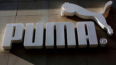 Puma ups outlook after Man City, basketball boost