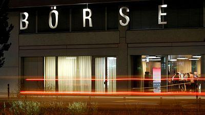 As bourse battle rumbles on, Swiss stock exchange scores early win