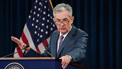 Fed cuts interest rates, signals it may not need to do more