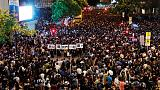 Thousands of Hong Kong civil servants defy government to join protests