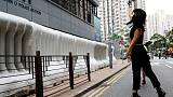 Hong Kong police fire teargas as China says it will not 'sit idly by'