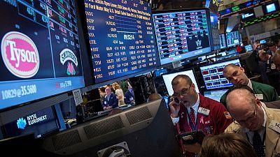 وول ستريت تفتح منخفضة مع تزايد مخاوف التجارة بسبب هبوط اليوان