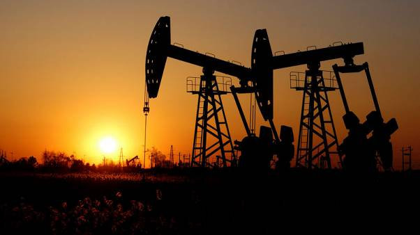 Oil prices edge up but U.S.-China trade war drags