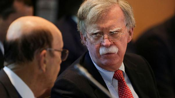 Bolton reminds Kim of missile pledge after North Korea warns of 'new road'