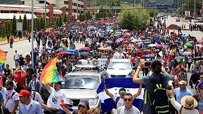 Thousands protest against Honduran president after drug link surfaces