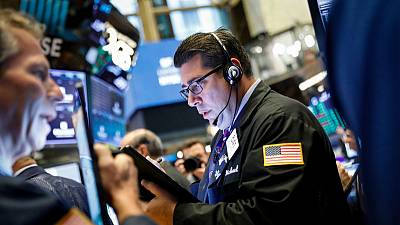 Rush into U.S. bonds curbs global stock markets; gold touches six-year high