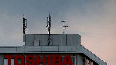 Toshiba quarterly profit jumps on cost cuts, but misses estimates