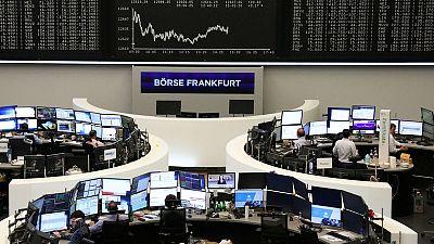 Chemical deals lift European shares, banks weigh