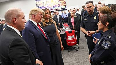 Trump visits mass shooting victims; protesters shout 'Do something!'