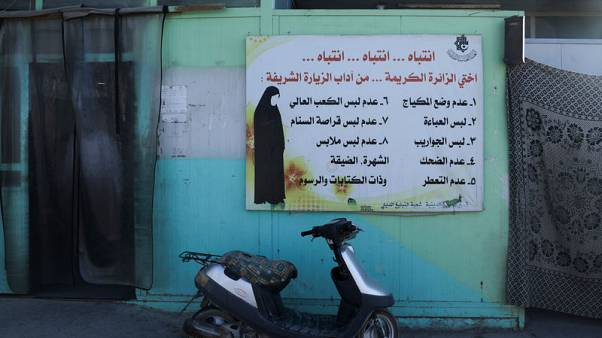In Iraqi holy city, row over female violinist at soccer match shows social rift