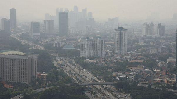 Indonesia's capital curbs private cars in bid to cut choking pollution