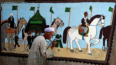 Egyptian artist paints murals on houses to celebrate haj