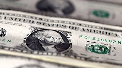 Dollar will be cut down to size if Fed gives in to market whims - Reuters poll