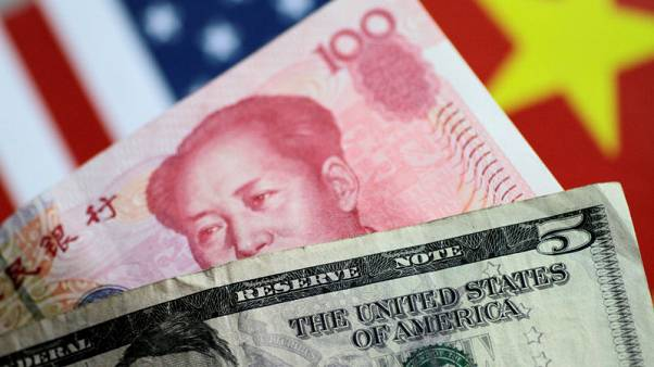 China sets yuan mid-point below key 7-per-dollar for first time since 2008