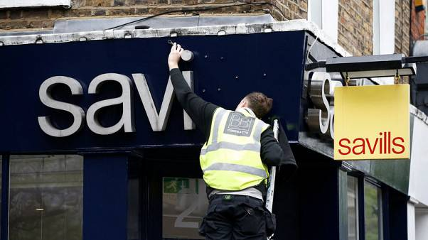 Trade war, Brexit hit Savills half-year profit