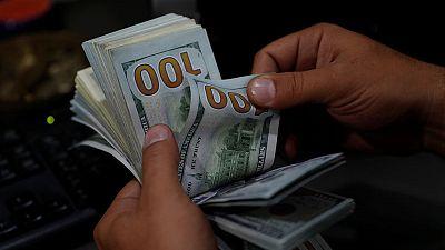 الدولار يتراجع بفعل تعافي الأسواق وبيانات صينية قوية
