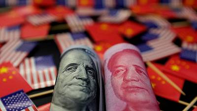 China lowers yuan mid-point to fresh 11-year low, but higher than forecasts