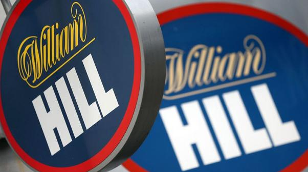 William Hill profit hit by regulatory cap, U.S. expansion costs