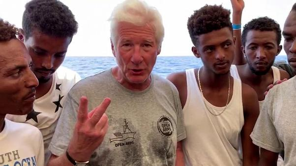 Hollywood star Gere visits stranded migrants on Open Arms ship