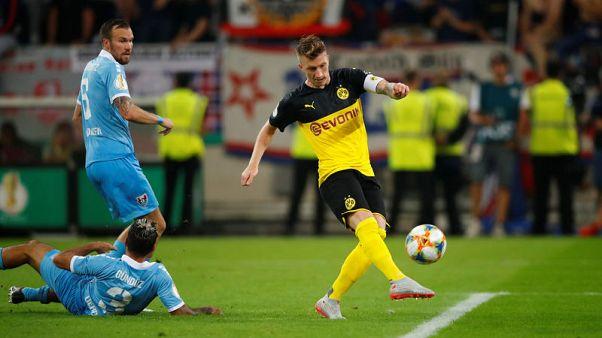 Dortmund work up a sweat to move past Uerdingen in German Cup