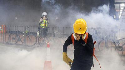 Hong Kong police fire tear gas during cat-and-mouse encounters