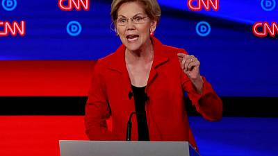 Democratic presidential contender Warren rolls out gun limit plan
