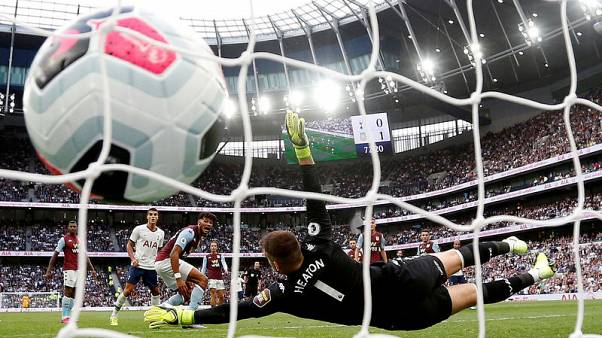 Kane scores late double to give Spurs win over Villa