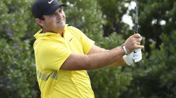 Reed takes Northern Trust lead, Johnson struggles