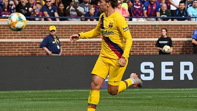 Griezmann fuels ultra-attacking Barca's bid for third straight title