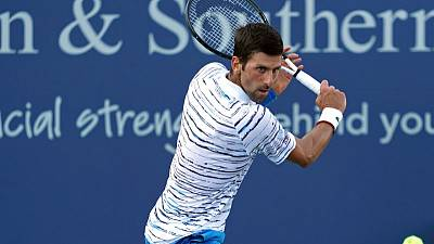 Djokovic shakes off rust, Federer rolls in Cincinnati